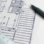 image of a blueprint with a pen and ruler